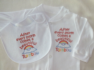 After a storm comes a beautiful rainbow embroidered sleepsuit , vest and bib